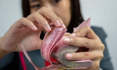 A girl holds money with hands
